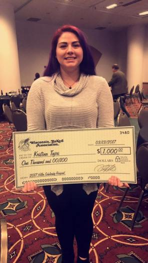Kristina Tajiri with scholarship check